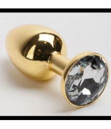 Золотистая анальная пробка с белым кристаллом - 7,6 см.