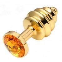 Золотистая пробка с рёбрышками и оранжевым кристаллом - 7 см.